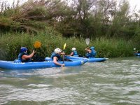 Canoists bypassing water obstacles