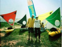 Posing in front of the kayaks under sail