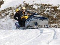 Snowmobile on ascending slope