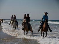 On horseback among the waves