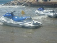 Two jet skis on the beach