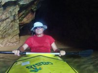 Departing with the kayak from the cave between the rocks