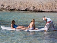 chicas en tabla de surf