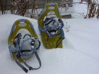 Leaving the snowshoes on the white mantle