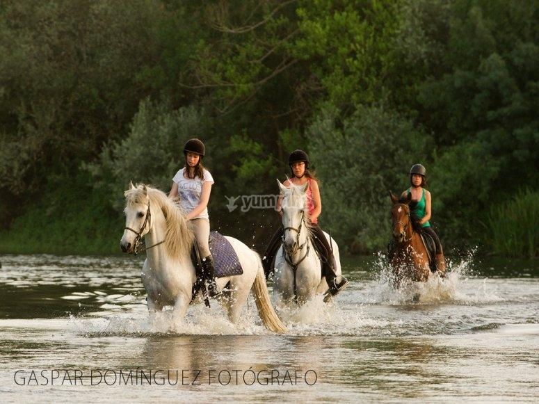 Riding a horse through the river