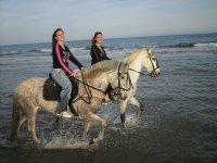 Riding through the beach