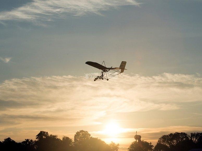 Ultralight flight with the sunset