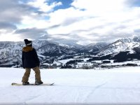 Looking at the mountain range from the snowboard