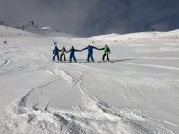 Snowboarders hand in hand