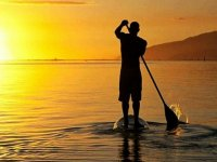 Paddle surf at sunset in Barcelona