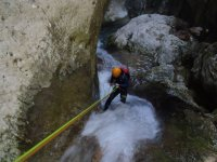 In the ravine helped by the rope