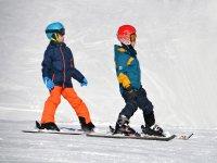 Guys learning to ski
