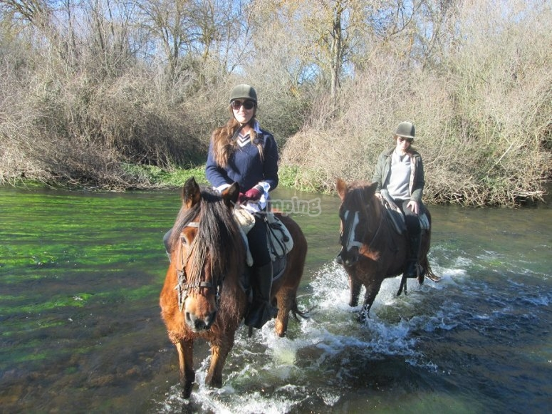 By horse through the river