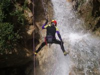Rappelling in a ravine