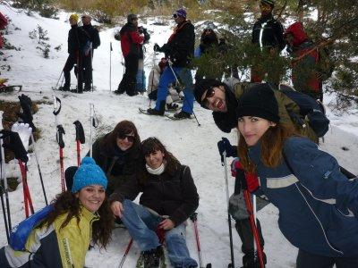 Raquetas de nieve de noche y cena en Navacerrada