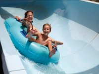Sliding down with the mother through the water slide