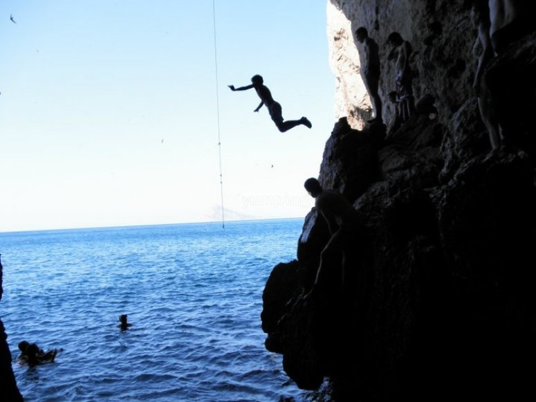 Jumping from the rock to the sea