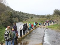 Crowd crossing the river to see the Fuentes caves of Lion