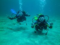 Divers at the bottom of the sea
