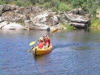 Couple in the canoe through Toledo