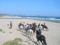 Departure on the beach on horseback