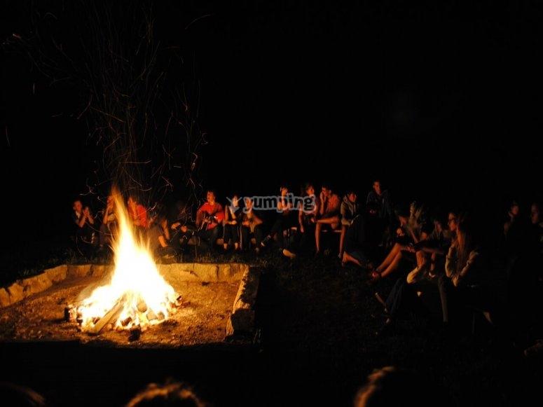 Next to the bonfire
