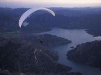 Paragliding over the river