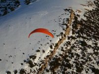 Paraglider flights in snowy areas