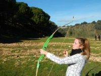 Disparando con el arco verde