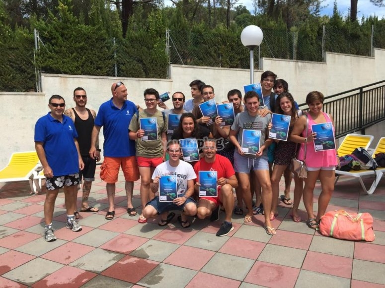 Showing the diplomas of diving baptism