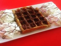 Waffle with chocolate and cream