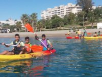 Young people paddling in the kayak