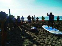 Attending the paddle surf teacher
