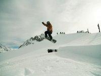Piruetas practicando snowboard