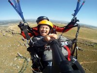 Flying a tandem paraglider over the mountains