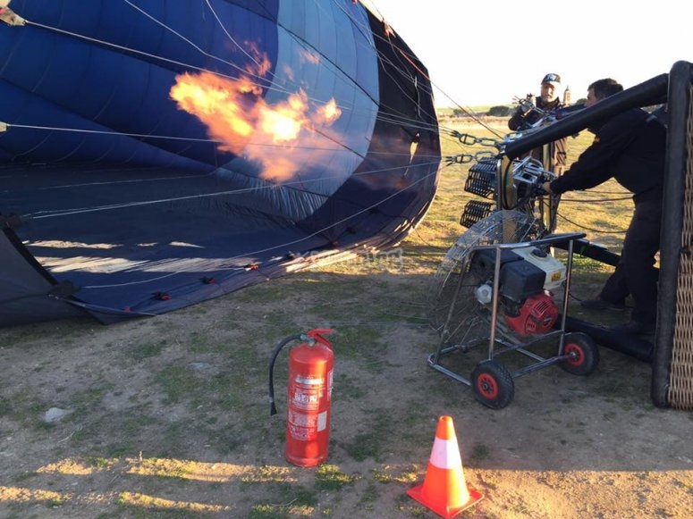Inflating the balloon with a burner