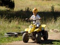 Child driving quad