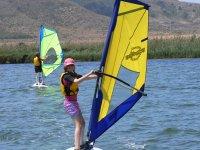 Girl windsurfing in Murcia