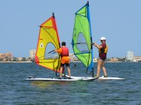 Mother and son windsurfing