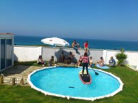 Pool and SUP surfboard