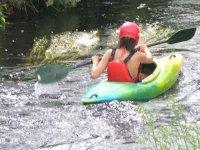 Kayaking through calm waters