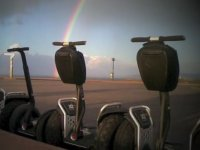 Segways with rainbow in the background