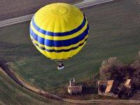 Yellow balloon ascending
