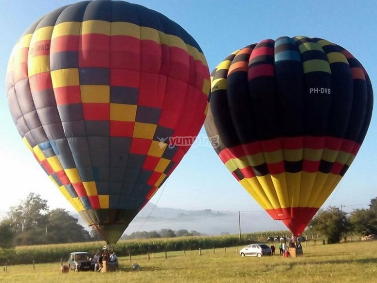 Two hot air balloons ready to flight