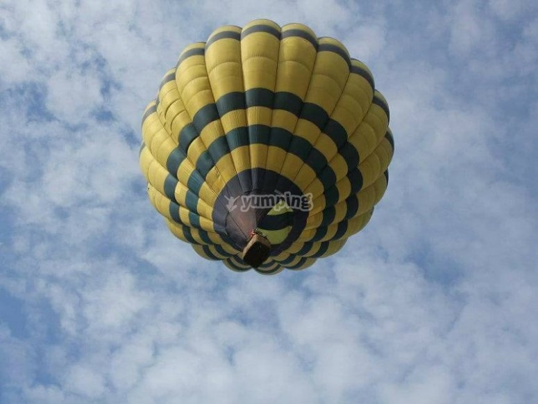 Hot air balloon reaching the clouds