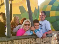 On the balloon with parents