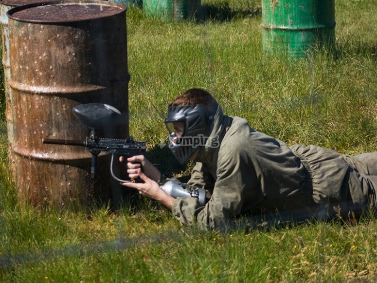 Lying down with the paintball gun
