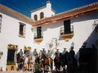 central courtyard of the hacienda with riders