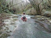 Crossing the flow of the ravine of Saturio