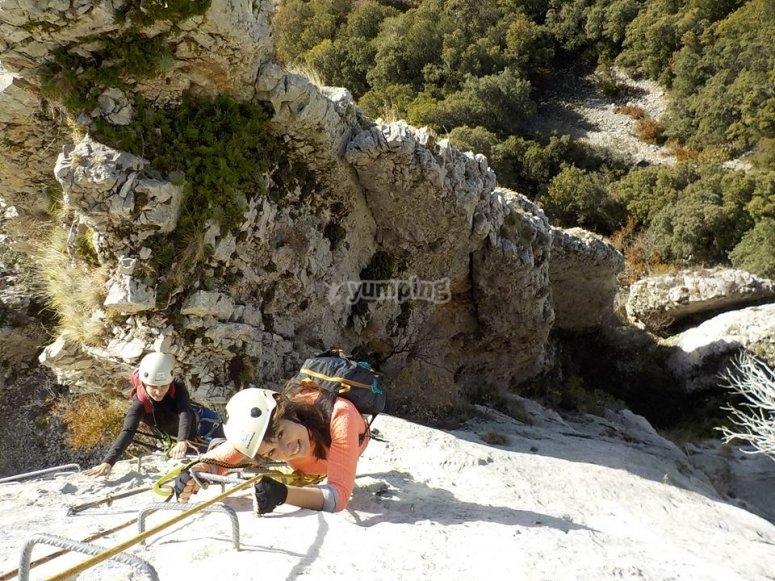 Ascending through the rocks of the ferrata in Torla
